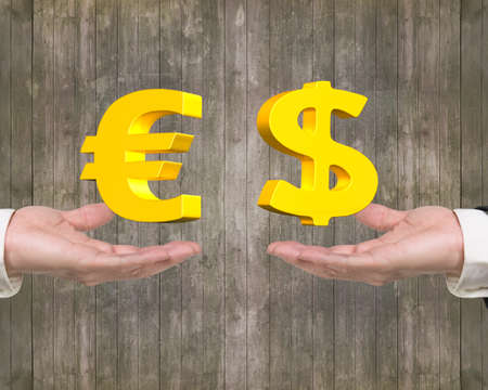 foreign exchange: Euro symbol on left hand and Dollar sign on right hand, foreign exchange concepts Stock Photo