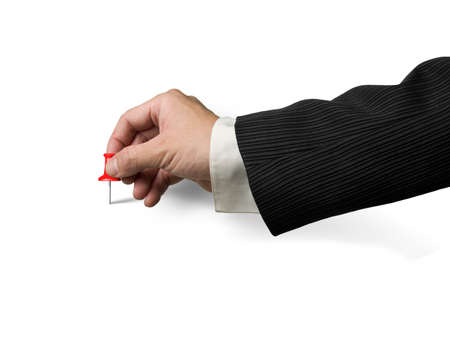 copy sapce: Male hand holding red pushpin tacked on white background