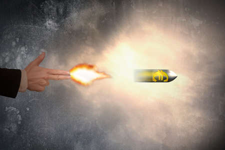 euro symbol: Hand of gun gesture with firelight shooting the euro symbol bullet