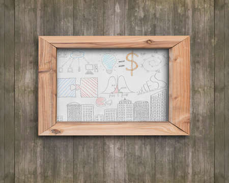 Whiteboard of wooden frame with business concepts doodles on old brown wood wall Stock Photo