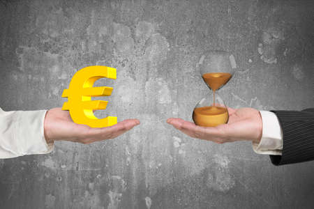 hour glass: Euro symbol on one hand and hour glass on another hand, with gray concrete wall background, concept of deal and time. Stock Photo