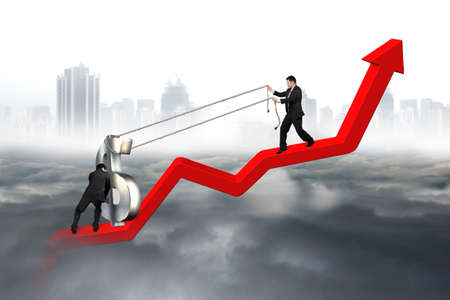 upward struggle: Two business men moving 3D dollar sign upward on red trend line with city landscape gray cloudscape background Stock Photo