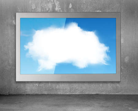 fullhd: White clouds sky image on wide flat TV screen, hanging on concrete wall background. Stock Photo