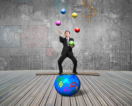 Businessman standing on wooden board and balancing on sphere, juggling with currency symbol balls; on doodles wall background.