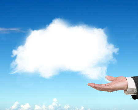 copy sapce: Male hand showing white cloud with blue sky background Stock Photo