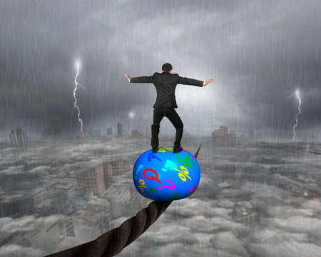 heavy rain: Businessman standing on top of colorful symbols ball, balancing on a wire, with heavy rain lightning overcast cityscape background.