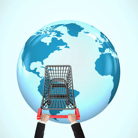 eshop: Hands pushing empty shopping cart on 3D globe with world map, global shopping concept.