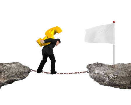 people holding sign: Businessman carrying golden dollar sign balancing on rusty chain, walking to white flag on cliff, with white background.