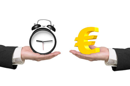 Euro symbol on one hand and alarm clock on another hand, isolated on white, concept of deal and time. Banco de Imagens