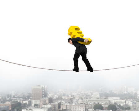 euro sign: Businessman carrying golden euro sign balancing on tightrope, with city background.