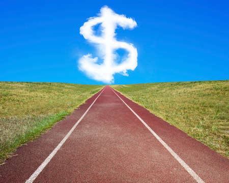 future sign: Dollar sign shape cloud in blue sky, with dark red running track and grass.