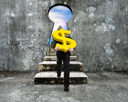 concrete steps: Man carrying golden dollar sign climbing old concrete stairs toward keyhole, with view of sky clouds.