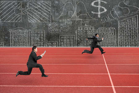 run faster: Two businessmen running on red track, with business concepts doodles wall background.