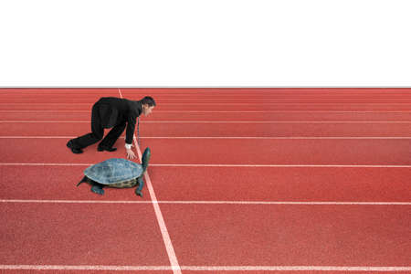 run faster: Businessman and turtle are ready to race on running track, isolated on white background. Turtle race competing metaphor concept. Stock Photo