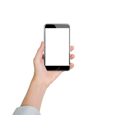 manos: Woman hands holding smart phone with blank white touch screen, front view, isolated on white. Foto de archivo