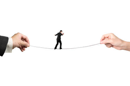 Businessman balancing on tightrope with man and woman hands holding two sides, isolated on white. Stock Photo