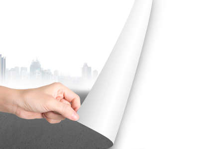 replace: Woman hand open blank white page to replace gray cityscape
