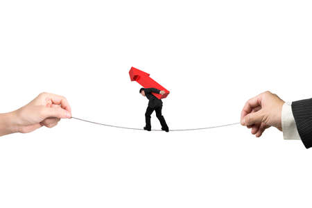 hard work ahead: Businessman carrying red arrow sign, balancing on tightrope with man and woman hands holding two sides, isolated on white. Stock Photo