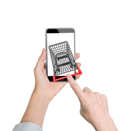 Female forefinger pushing small shopping cart on smartphone of white screen, front view, isolated on white, on line shopping concept.