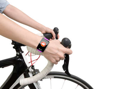 Closeup on biking woman hands wearing health sensor smart watch, isolated on white background.