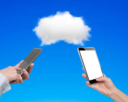 transferring: Two women using smartphones to exchange information, transferring data from white cloud, on blue background.