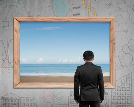 beach window: Rear view businessman looking at wooden frame window with view of sky sea beach, on business concept doodles wall background.