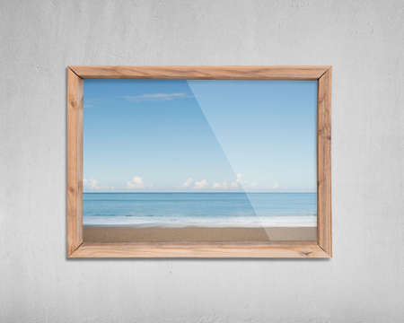 beach closed: Wooden frame window with view of sky sea beach, on concrete wall background. Stock Photo