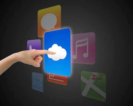 index finger: Female index finger touching cloud icon button with colorful apps, on black background. Stock Photo