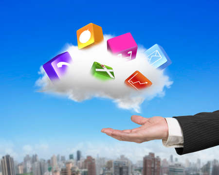 application icons: Male hand holding white cloud with colorful app blocks, on sky cityscape background.