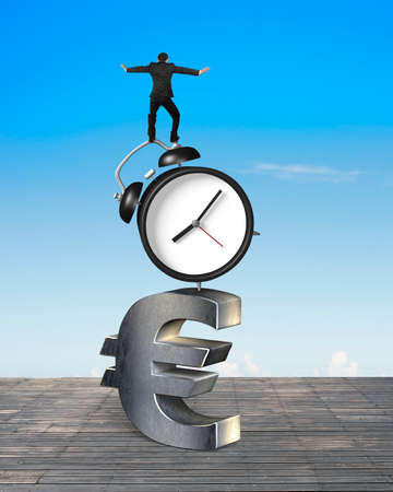 euro sign: Businessman balancing on alarm clock and euro sign, on sky and wood floor background. Stock Photo