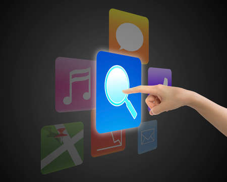 keywords link: Woman hand touching search icon button with colorful apps.