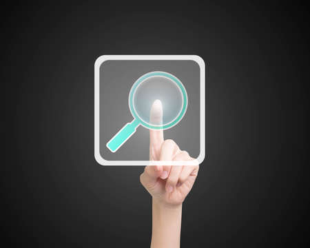 keywords link: Female index finger touching search icon button, on black background.