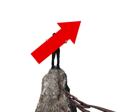 iron chain: Man holding red arrow up sign, standing on mountain peak with rusty iron chain, isolated on white.
