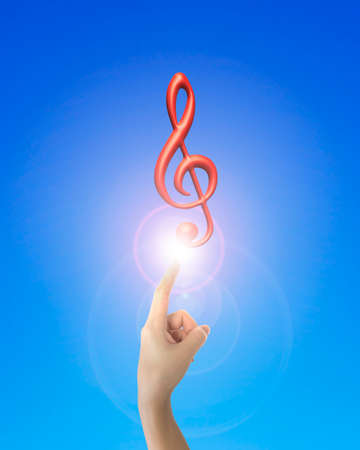 3d music: Human hand forefinger pointing at 3D music note with bright light, on blue background.