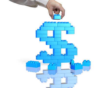 dollar signs: Human hand holding a blue block to complete dollar sign shape, isolated on white background.