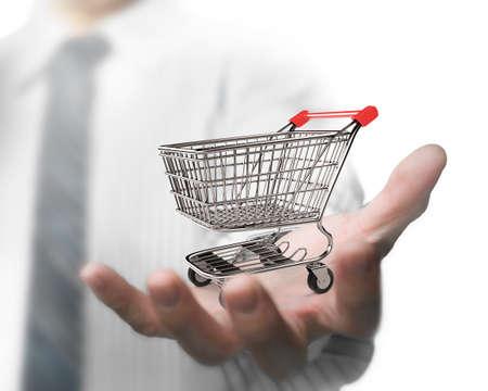 empty shopping cart: Business man hand holding empty shopping cart