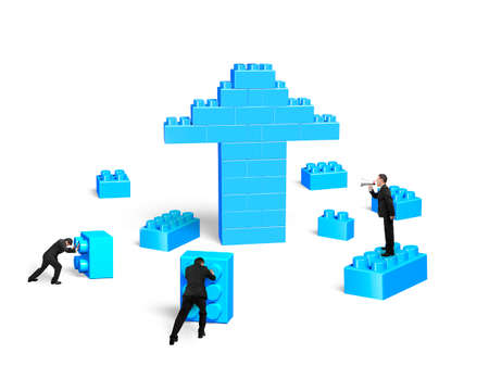 team effort: Businessmen building stack blocks in arrow up shape, isolated on white background. Teamwork concept.