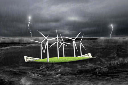 electricity supply: Wind turbines on money boat with wave and storm floating in the ocean Stock Photo