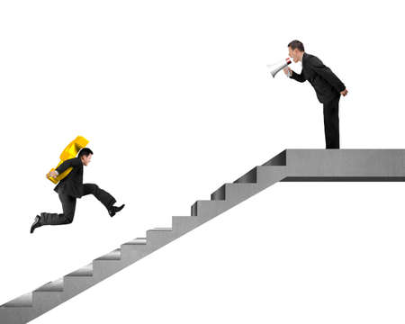 Businessman, employee  carrying USD running on concrete stairs with boss holding speaker yelling at Stock Photo