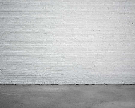 building material: room interior with white brick wall and concrete floor, nobody, empty