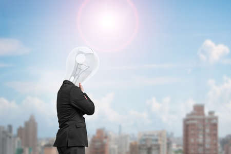 man side view: Man side view with lamp head thinking in sunny day,  city view background