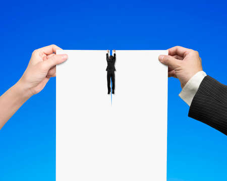 breaking the rules: Man and woman hands holding the tearing contract blank white paper with businessman hanging on it, isolated on blue.