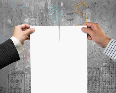 breaking the rules: Two mans hands holding the tearing contract paper with blank white, on business concept doodles concrete wall background.