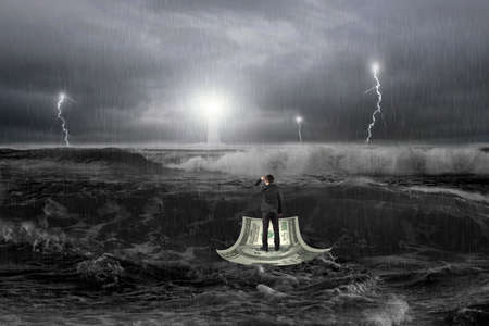 gazing: Man gazing on money boat floating in the ocean with storm, thunder, lightening and lighthouse in front
