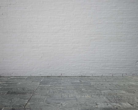Empty room interior with whit brick wall and stone floor Banco de Imagens