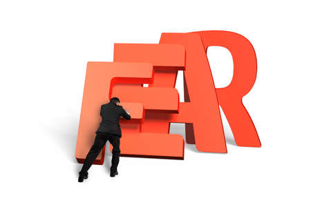 exert: Man pushing domino of red fear word falling, rear view, isolated on white.
