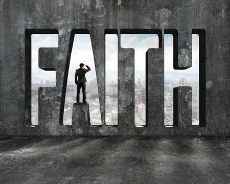 gazing: Faith word on concrete wall with man gazing on view of sky and city buildings. Stock Photo
