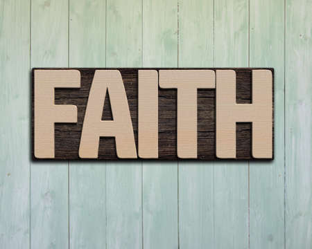 prinitng block: Faith wooden word on green wood wall.