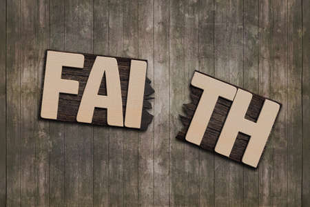 prinitng block: FAITH word with broken board on wooden wall background.