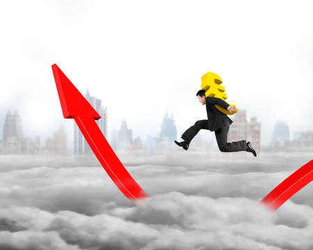 euro sign: Man carrying golden Euro sign running on growing red arrow graph, on city skyline cloudscape background.